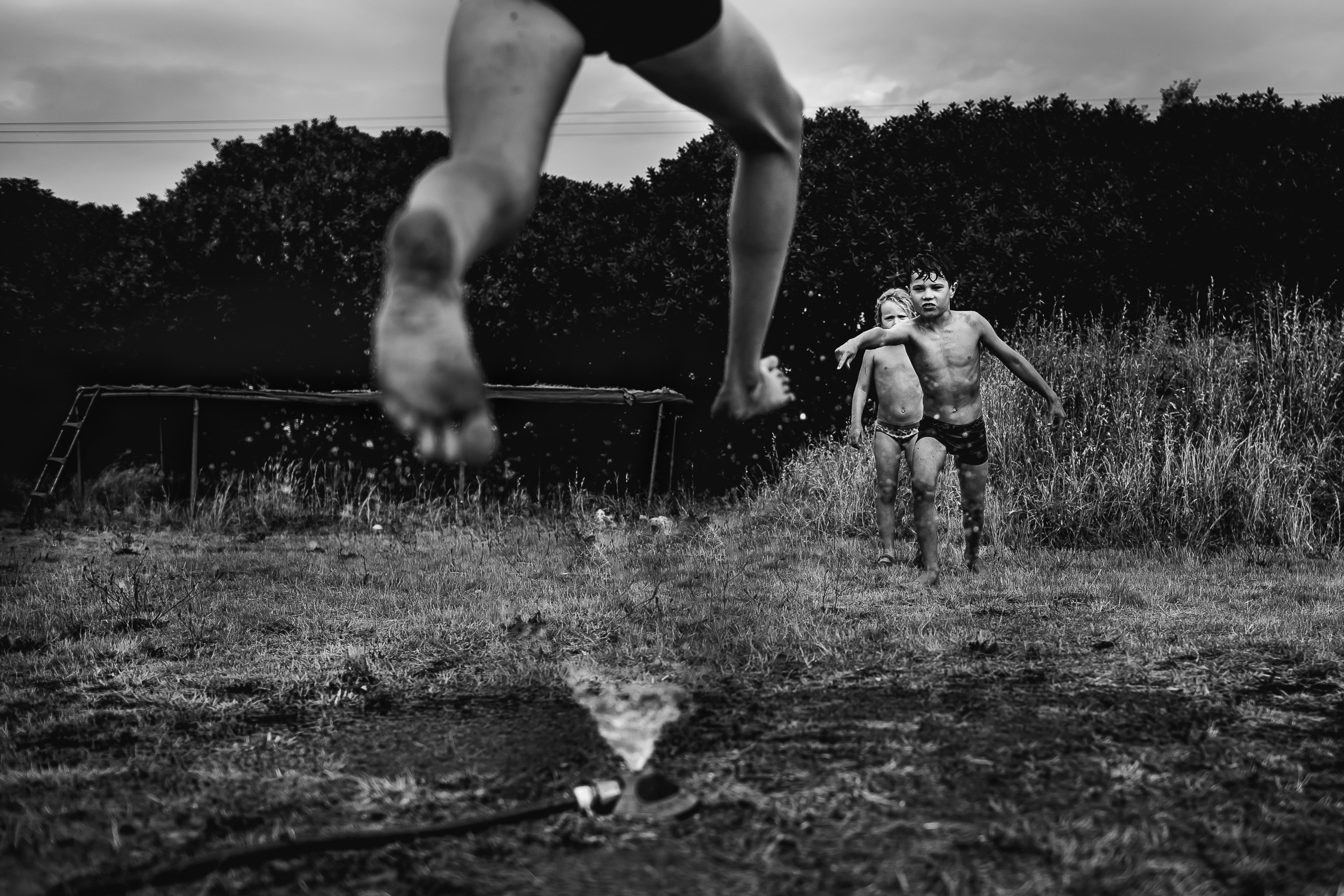 Niki Boon, Jump, Summer, 2015, boy jumping over sprinkler